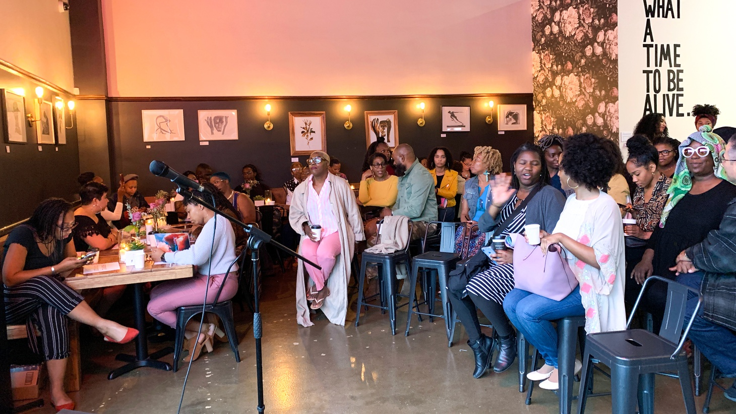 A packed crowd waits for the Free Black Women's Library event to start at Hilltop Coffee + Kitchen.