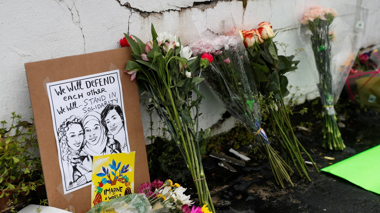 Flowers and a poster are left outside Gold Spa following the deadly shootings in Atlanta, Georgia, U.S. March 17, 2021.