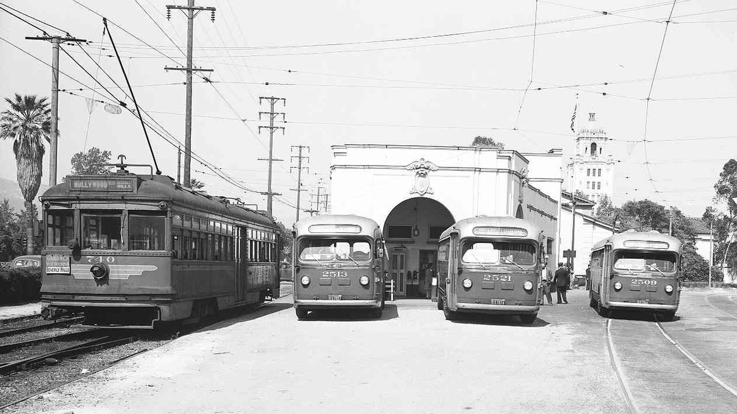 Pacific Electric Railway streetcar no. 740 beside buses nos. 2513, 2521, and 2509 at Beverly Hills station.