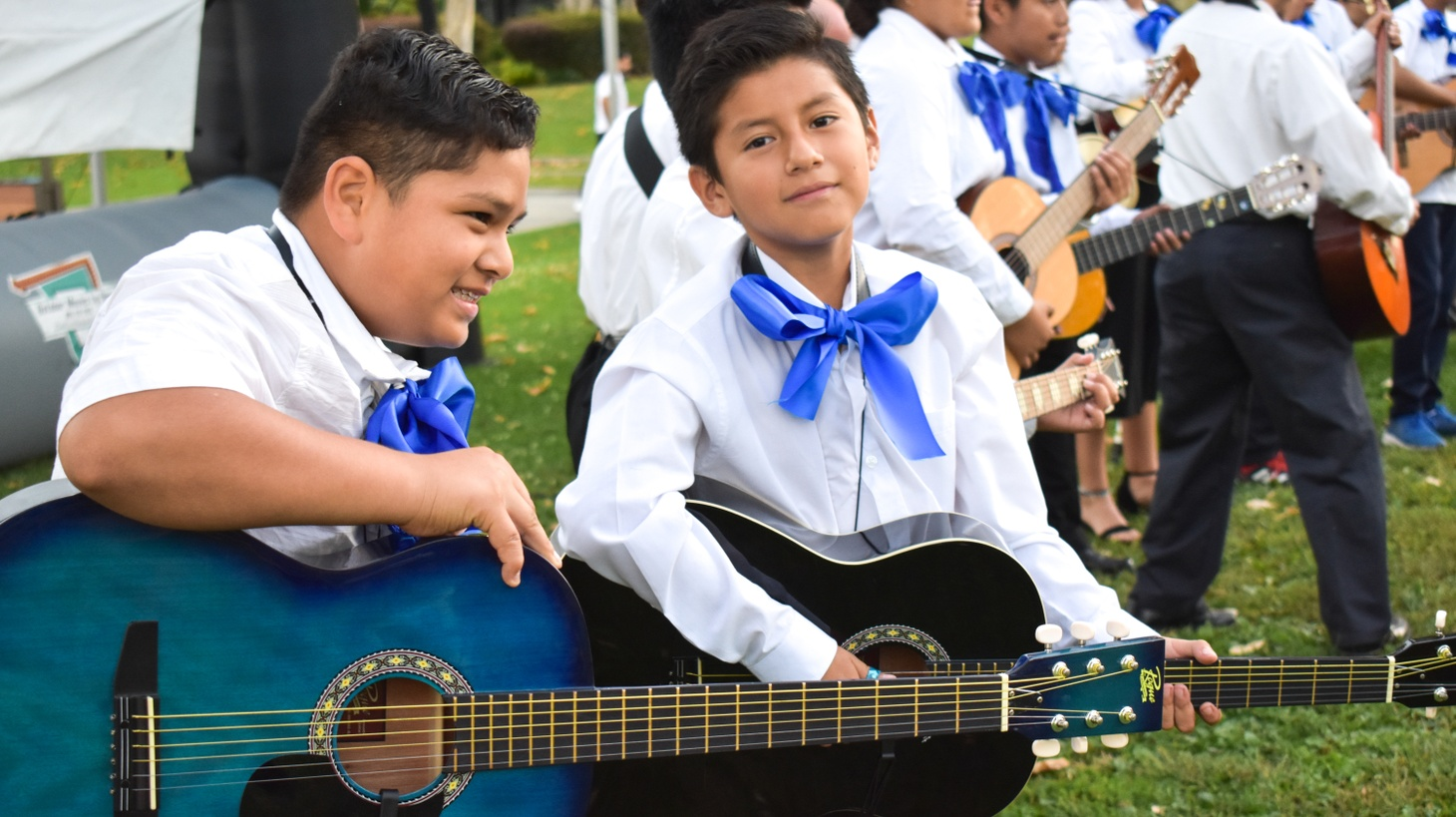 Two young guitar players in SMYO's mariachi ensemble.
