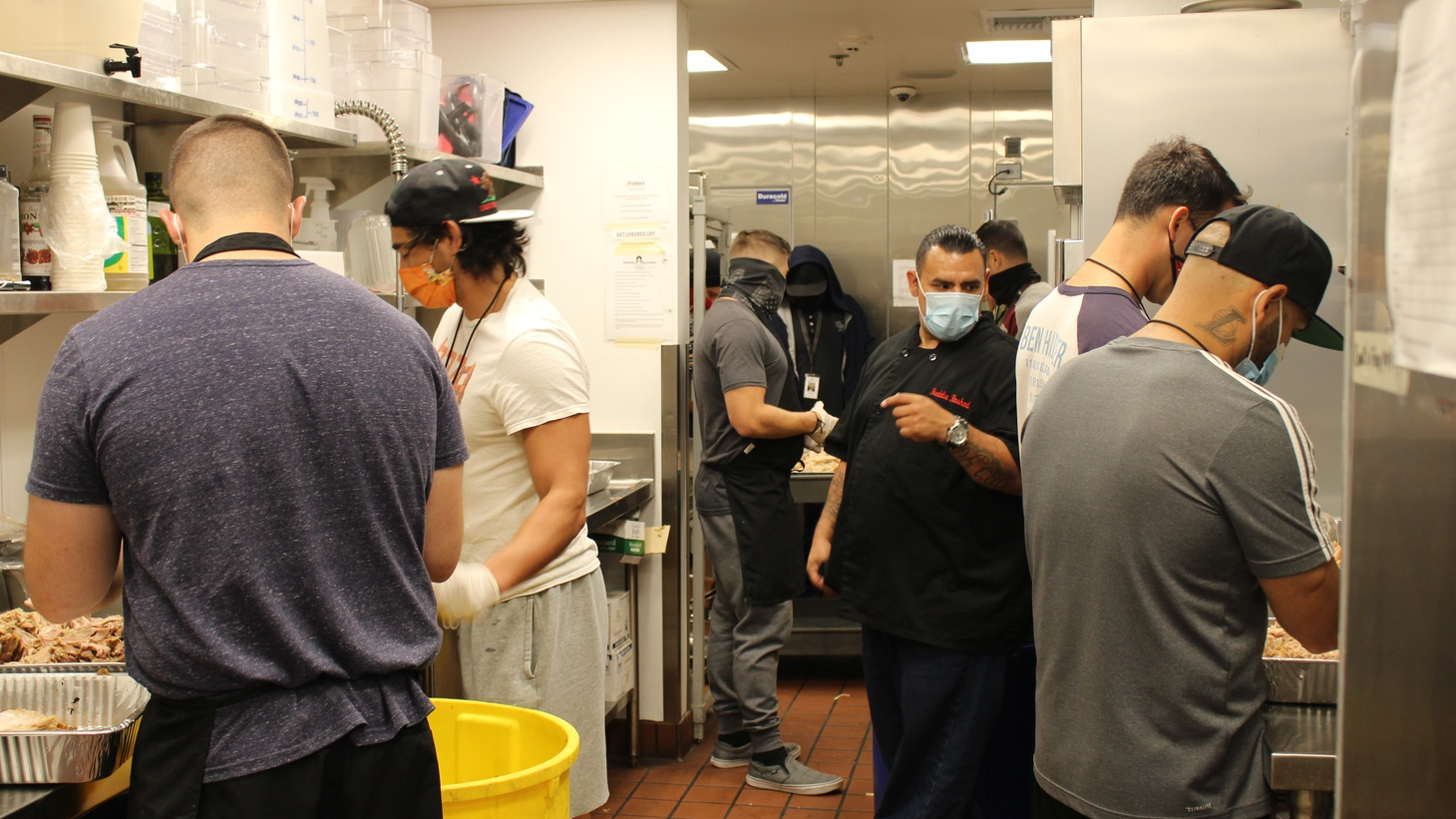 Men from the Santa Barbara Rescue Mission's drug and alcohol treatment program debone turkeys for the annual Thanksgiving dinner for people experiencing homelessness.