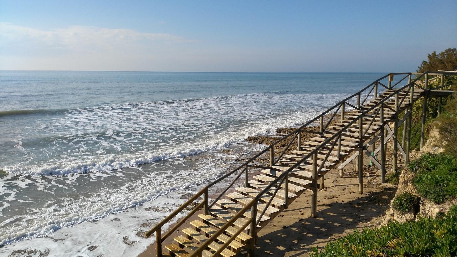 A staircase down to the beach.