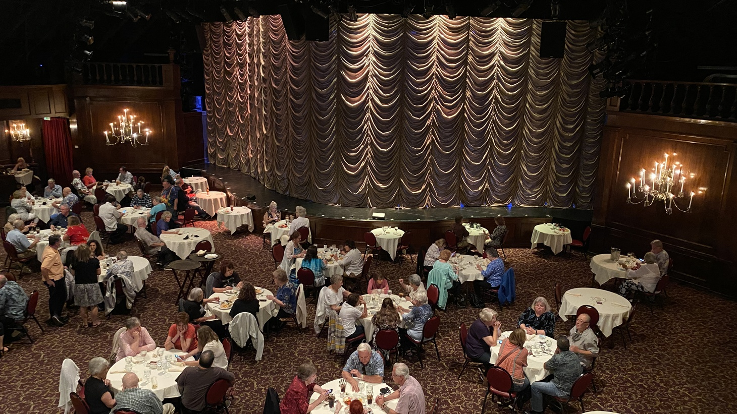 The Candlelight Pavilion's (re)opening night audience snacks and sips ahead of the evening's concert by Beatles tribute band Ticket to Ride. The venue has implemented a range of safety procedures, including extra distance, staggered seating times, and mandatory proof of vaccination or a negative COVID test within 72 hours of the event.