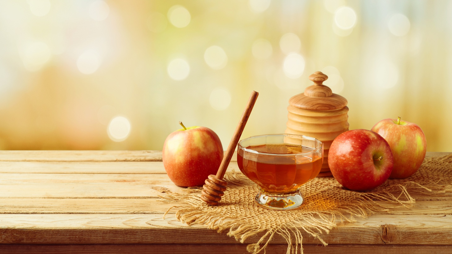 Rosh Hashanah involves the tradition of eating apples and honey to ensure a sweet new year.
