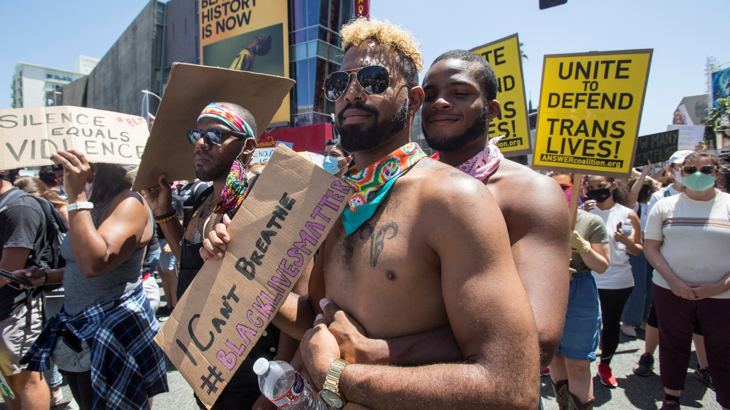 """""""Unite to defend trans lives!"""" is written on one of the signs in this All Black Lives Matter march in Hollywood, Los Angeles, California, U.S., June 14, 2020. The march was organized by Black LGBTQ+ leaders in the aftermath of the death of George Floyd."""