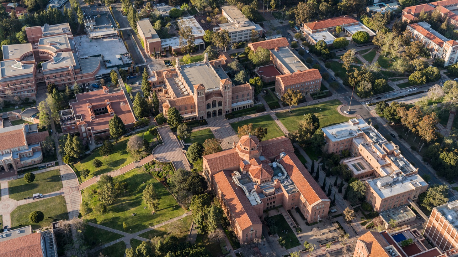 This aerial view shows UCLA's Royce Hall, Powell Library, and surrounding north campus buildings. The University of California is requiring students and faculty to submit proof of COVID vaccination to access on-campus facilities.