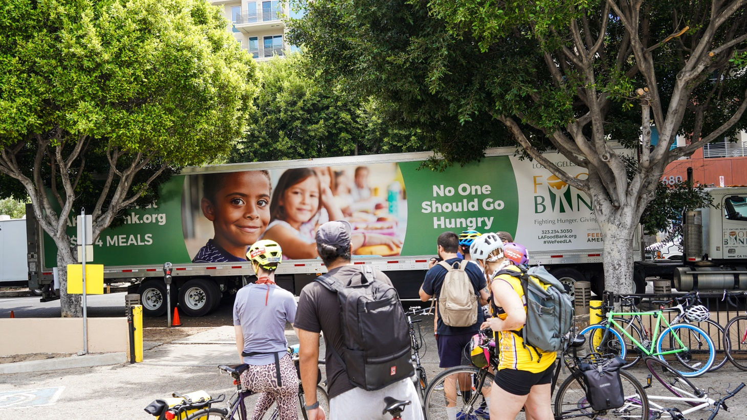 Bicycle Meals volunteers prepare to head out and deliver meals to unhoused residents in Koreatown.