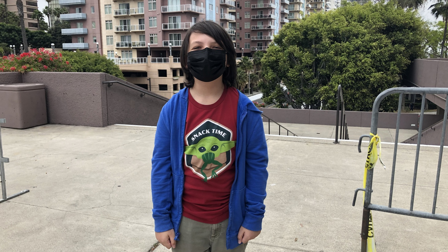 """12-year-old Brady Bond got vaccinated at the Long Beach Convention Center today. """"I'm excited to go to movie theaters again, start hanging out with friends, and do more activities like going to theme parks,"""" he said."""