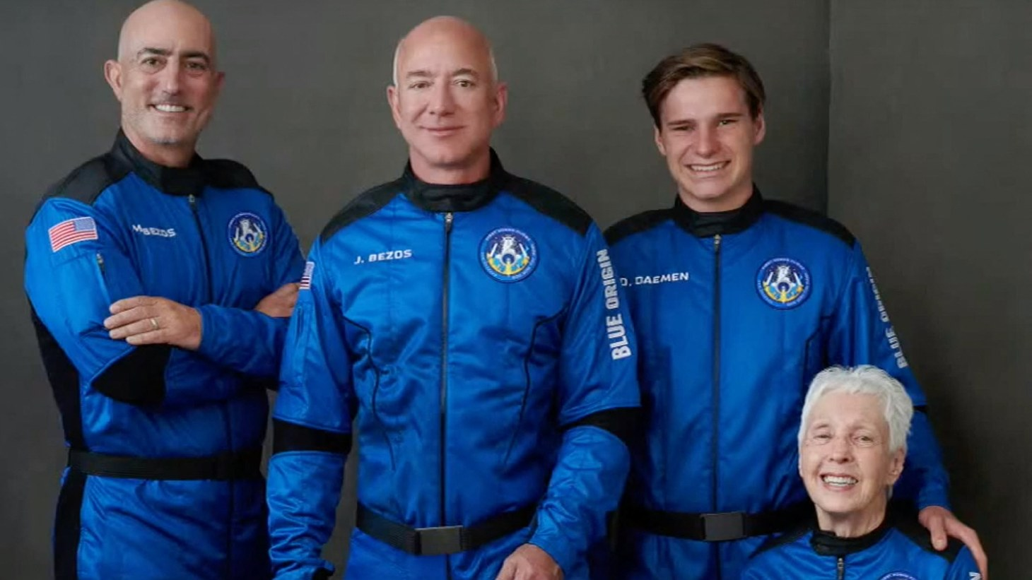 Jeff Bezos (second from left) stands next to his brother Mark Bezos (left), 82-year-old aviator Wally Funk (seated), and 18-year-old Oliver Daemen (right) of the Netherlands. All are part of the Blue Origin team being sent into space. July 20, 2021.