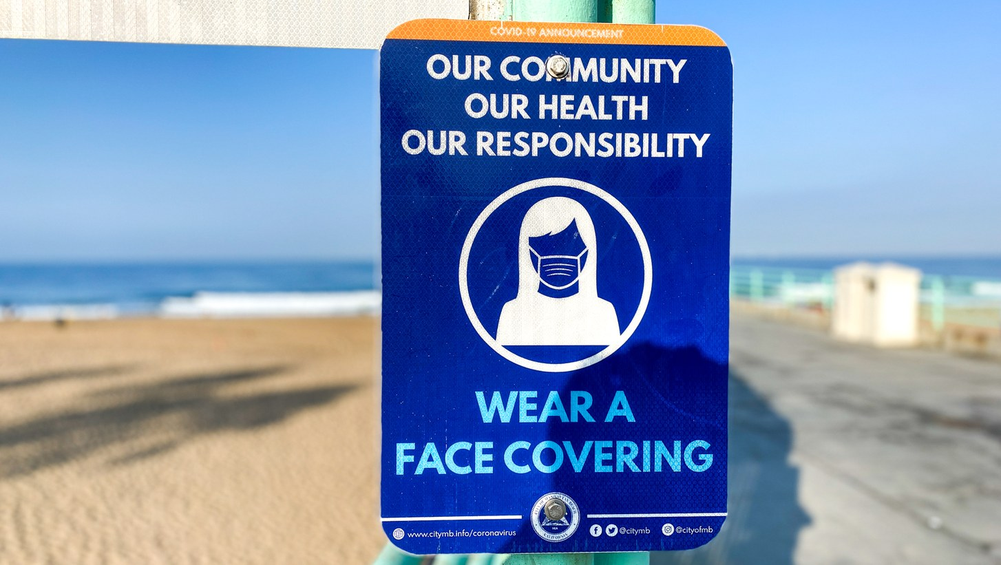 A sign at Manhattan Beach Pier advises people to wear face coverings. September 3, 2020.