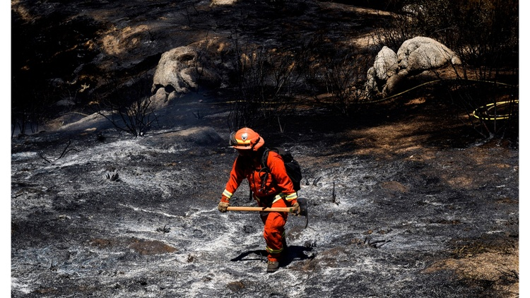 Nearly a third of the crews fighting wildfires in California are serving time in jails and prisons.