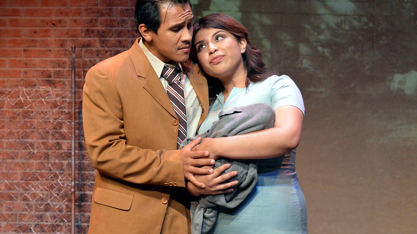 """Rufino Romero (Luis J. Rodriguez -- Chin) and Haylee Sanchez (Camila) with baby Ramiro Rodriguez in the world premiere production of """"Always Running,"""" based on the memoir by Luis J. Rodriguez."""