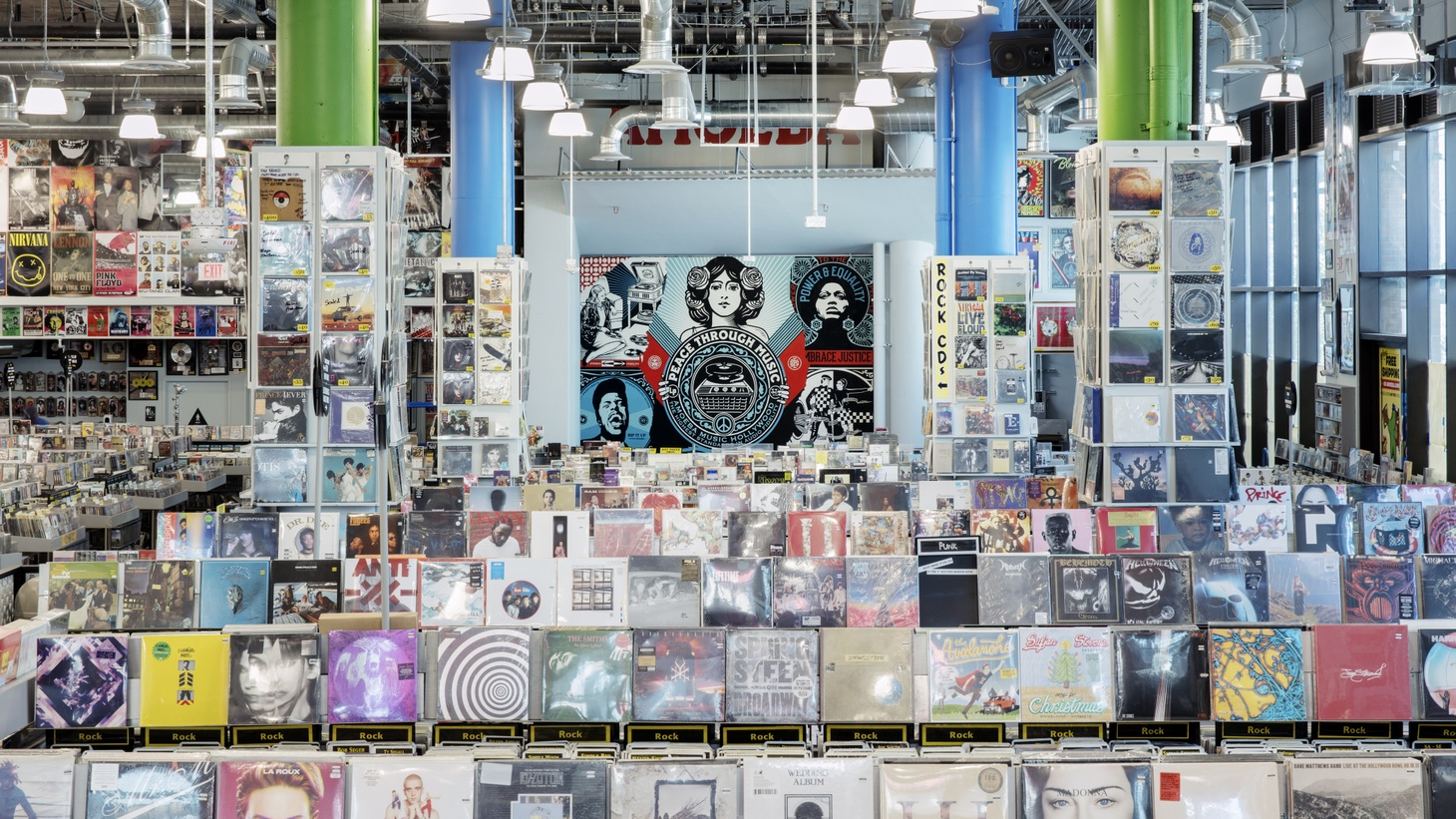 The new Amoeba Hollywood location features an in-store performance stage with a mural by Shepard Fairey.