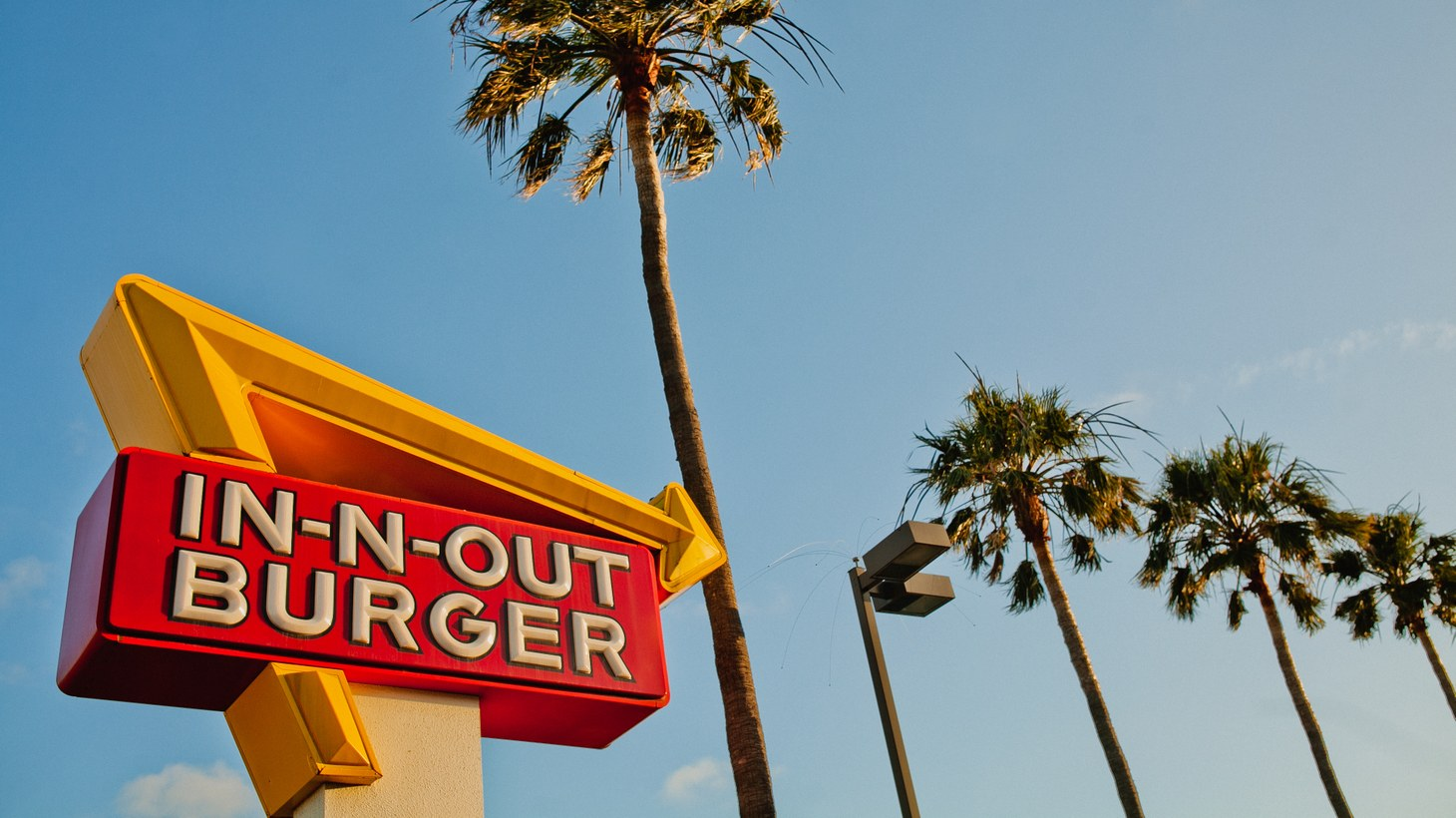 """In-N-Out Burger is taking an Australian food delivery joint called In & Out Aussie Burgers to court, accusing the alleged pretender to ride on the coattails of the Southern California company. """"If you have a look at their menu, it's pretty similar in broad terms to what the original In-N-Out offers. It's got burgers, it's got fries, it's got onion rings — controversially, thick shakes,"""" says Georgina Mitchell, a court reporter for the Sydney Morning Herald."""