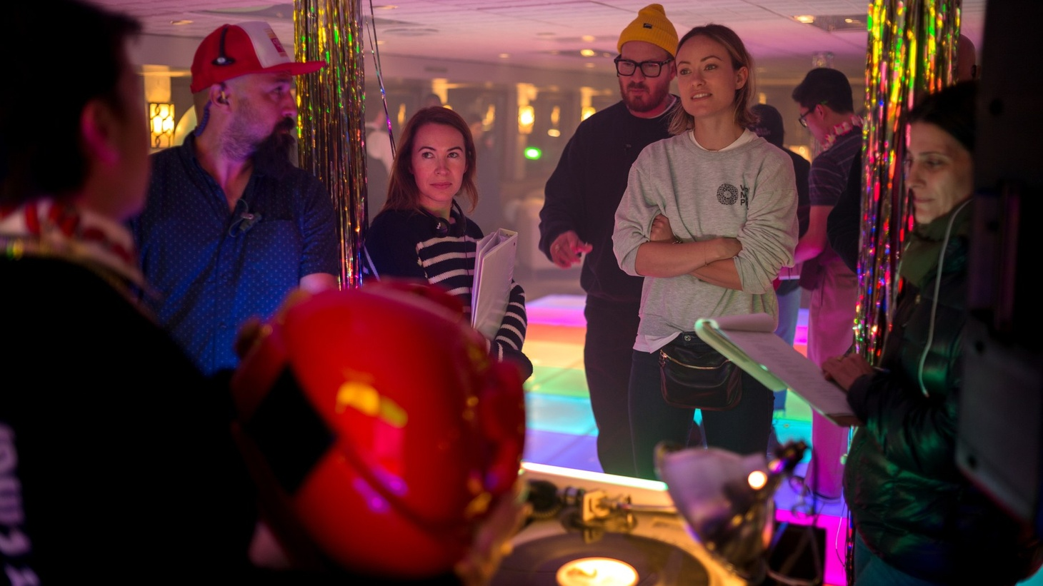 "Writer Katie Silberman, director of photography Jason McCormick and director Olivia Wilde on the set of ""Booksmart."""