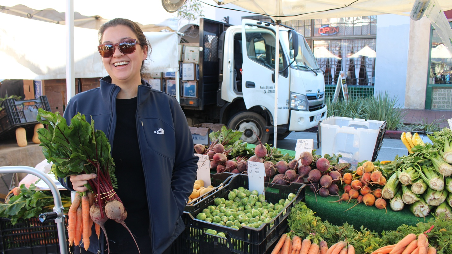 Christina Olufson picking up fresh ingredients to bring back to Bossie's.