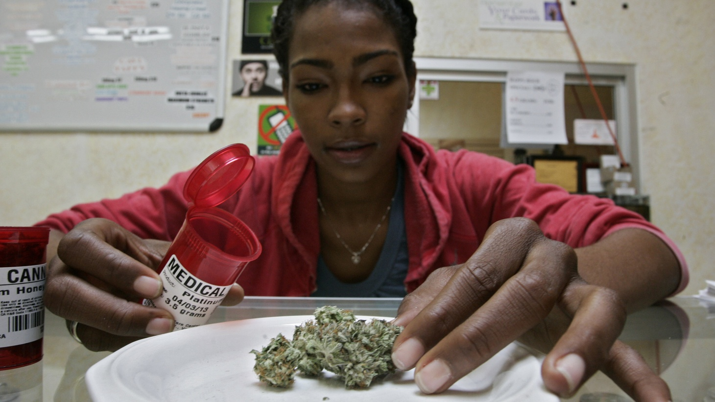 Ayrn Taylor, a United Food and Commercial Workers union (UFCW) member and employee at the Venice Beach Care Center, displays medical marijuana during a media visit at the medical marijuana dispensary in Los Angeles, California February 6, 2013.