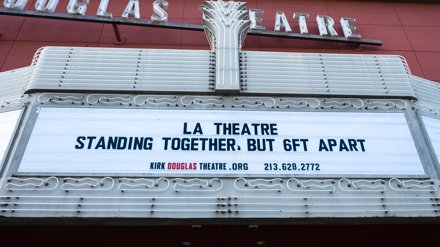 "The Kirk Douglas Theatre in Culver City has shut down all performances and is encouraging social distancing. The sign reads, ""LA Theatre standing together, but 6 ft apart."""