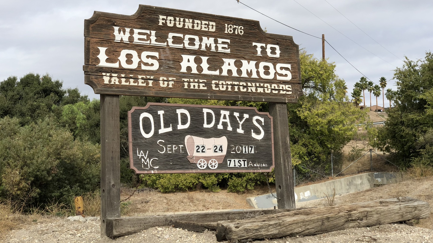 This sign welcomes you to Los Alamos, where there are lots of wineries, restaurants, and even an antiques depot.
