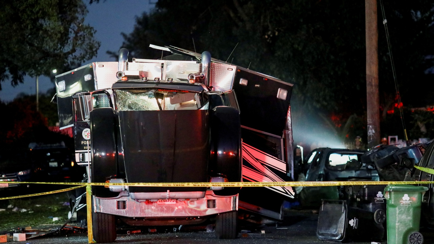 A damaged vehicle is seen at the site of an explosion after police attempted to safely detonate illegal fireworks that were seized, in Los Angeles, California, U.S., June 30, 2021.