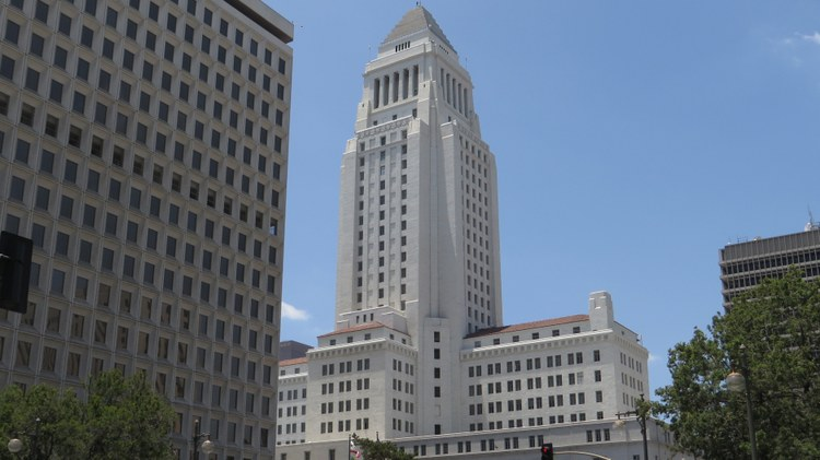"A Los Angeles real estate consultant has agreed to plead guilty to a federal racketeering offense for participating in a ""pay-to-play"" schem  e     at LA City Hall."