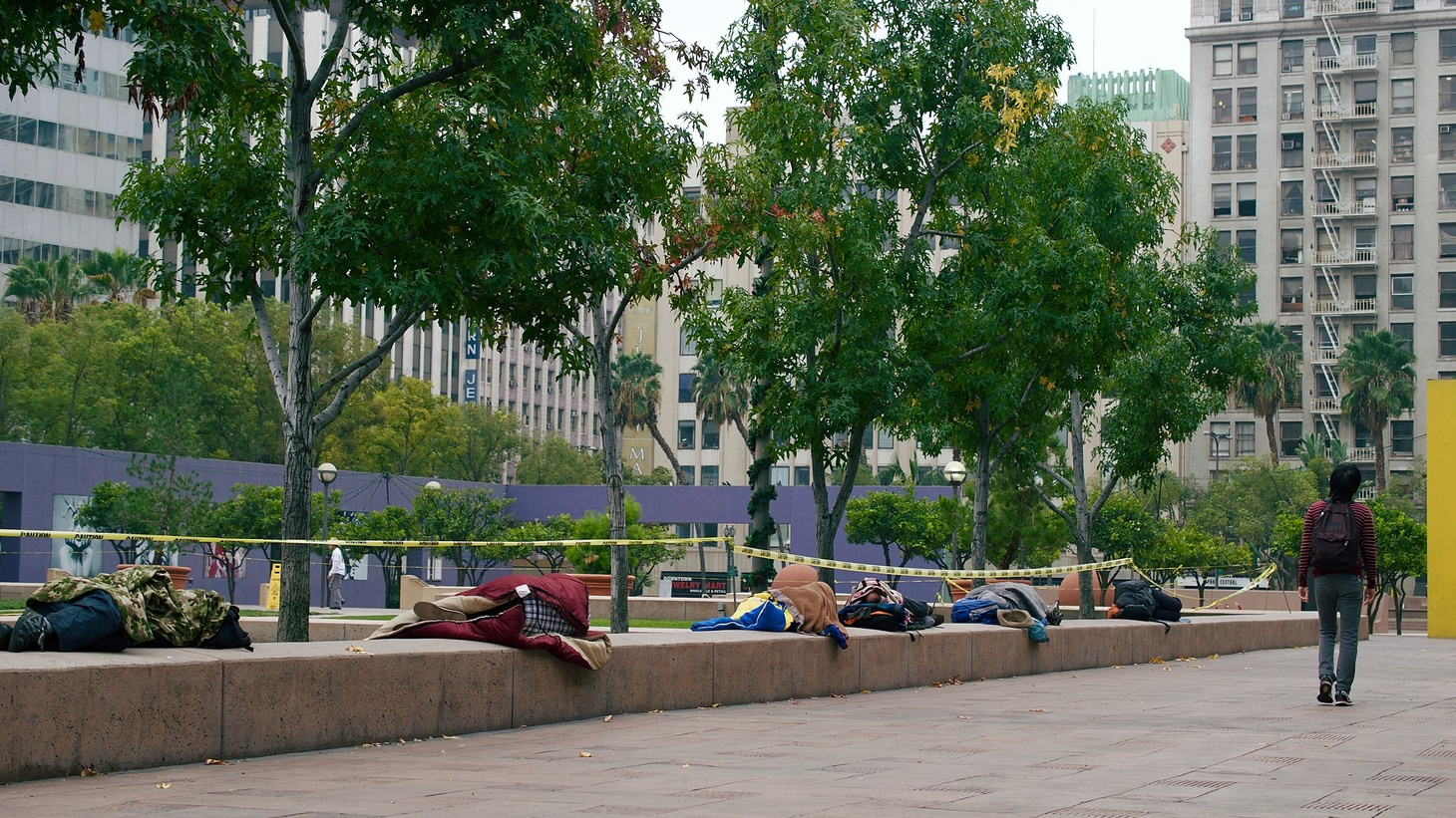 Homeless people sleeping in Pershing Square in Downtown Los Angeles