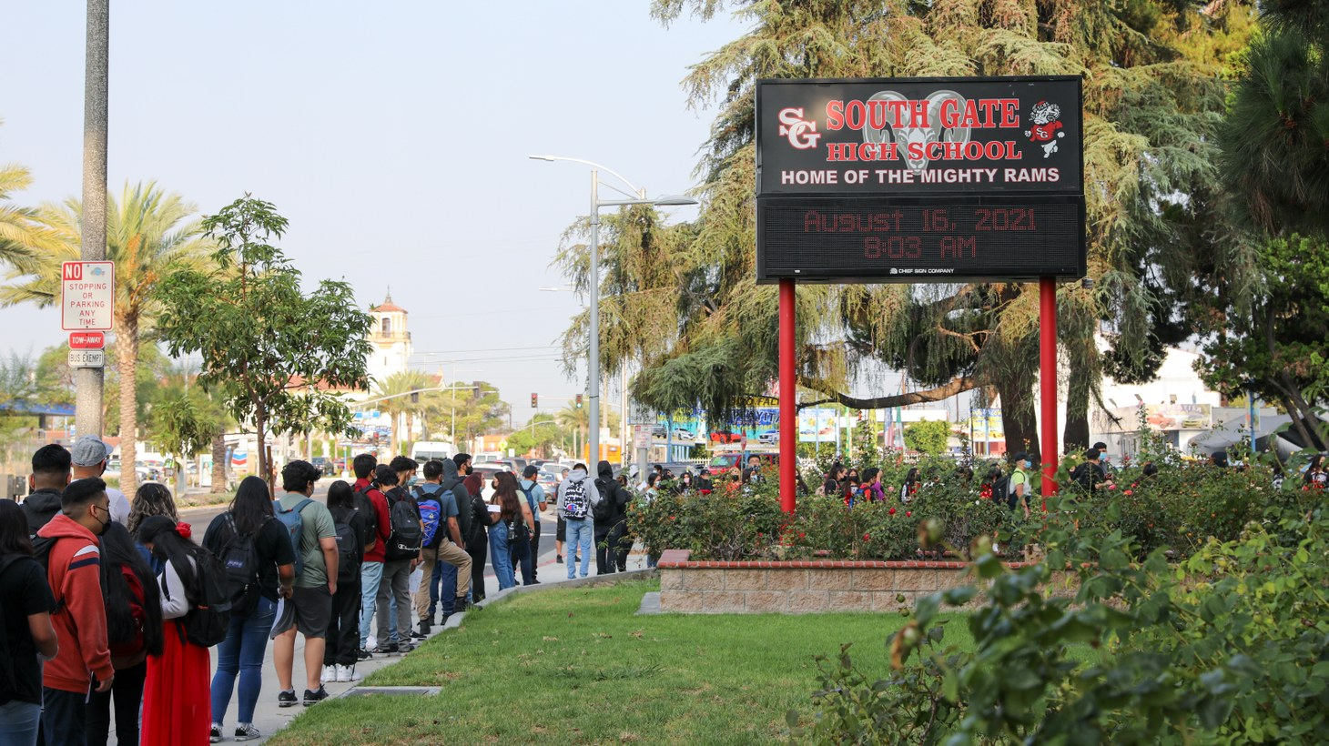 Students line up outside South Gate High School, waiting to receive their Daily Pass to enter campus, August 16, 2021.
