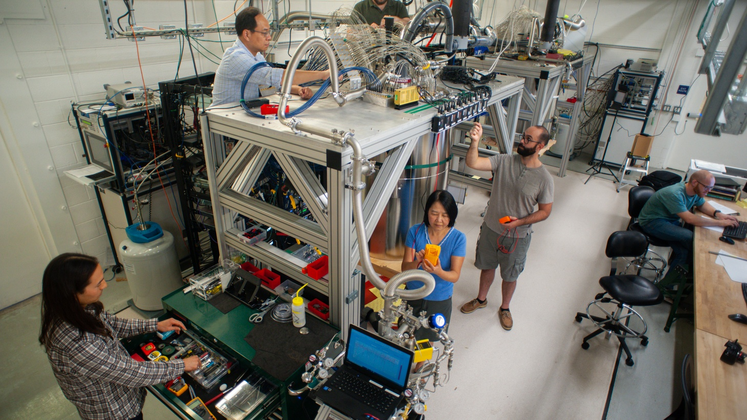 Scientists and engineers at Google maintaining the dilution refrigerator that houses the Sycamore chip used to demonstrate the quantum supremacy experiment.