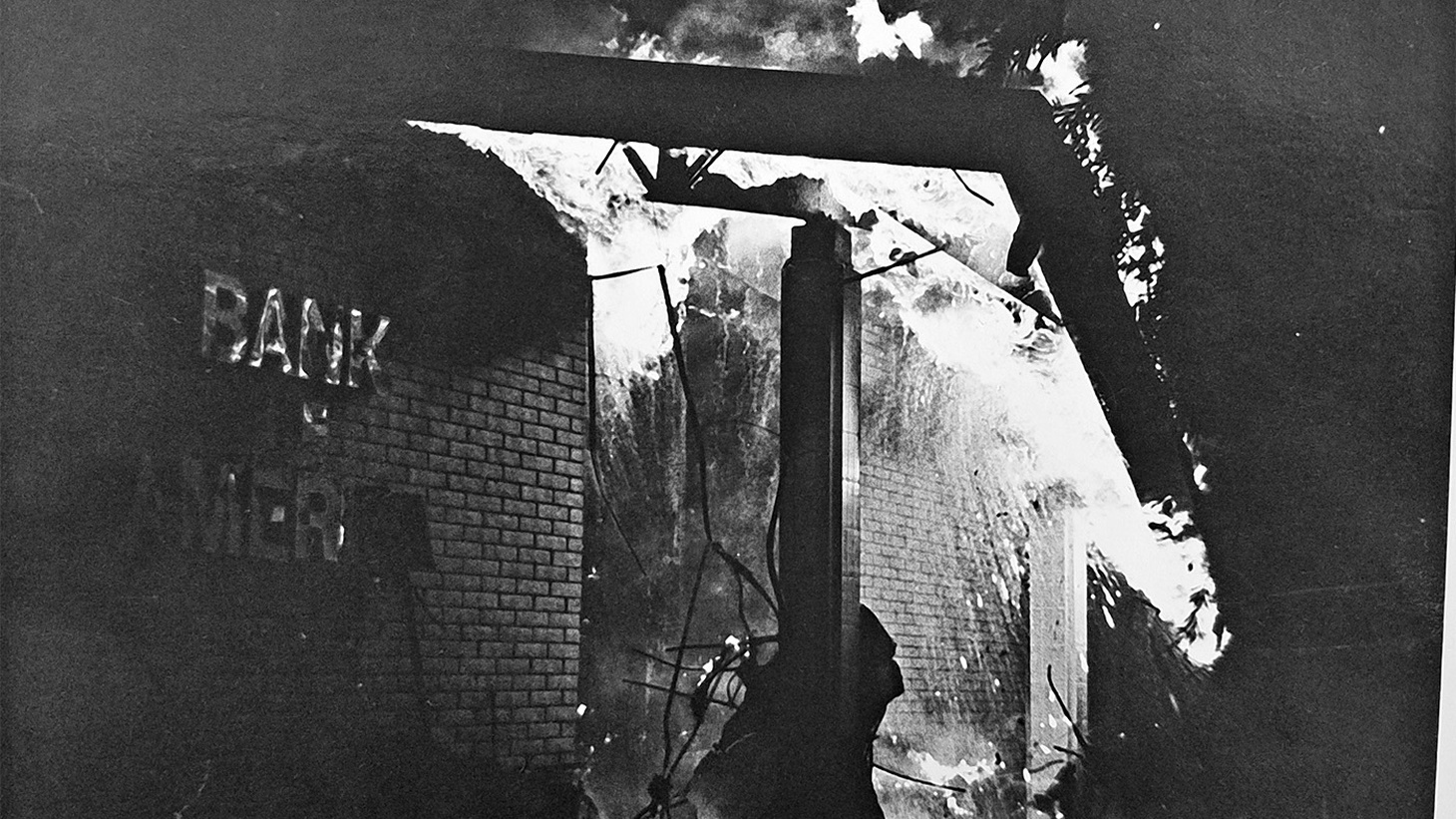 The Bank of America building on fire in Isla Vista on February 25th, 1970.