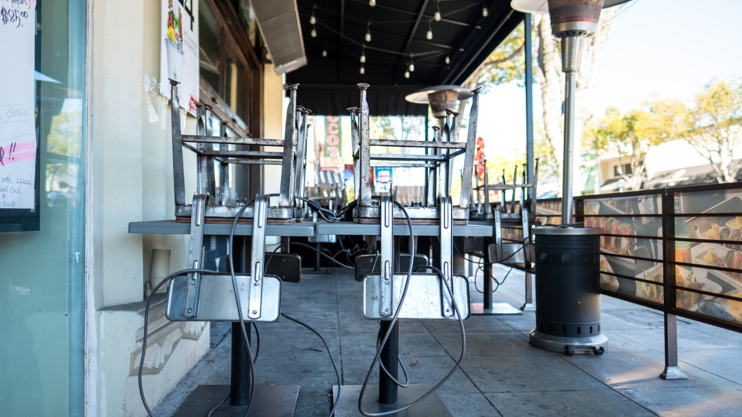 At a Japanese restaurant in Culver City, California, chairs sit on top of tables at the outdoor dining area, January 21, 2021. Outdoor dining in the LA area was banned starting in mid-December. But late January 2021, Gov. Gavin Newsom is lifting his statewide stay-at-home order.