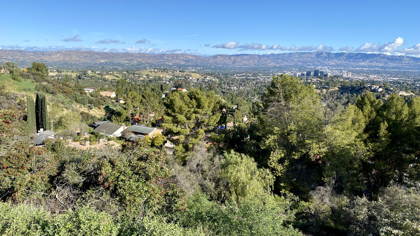 The view of Los Angeles from Topanga Canyon overlook. Skies in LA have been cleaner as residents are staying home due to COVID-19. How can we maintain environmental gains when the economy is reopened? March 2020.