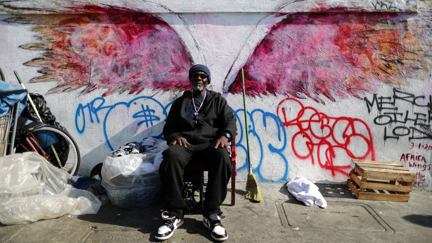 Willie Bassie, 58, sits next to his tent on Skid Row in Los Angeles, October 14, 2019. A new report shows more than 66,000 people are unhoused, despite a multi-million dollar measure aiming to bring help to the streets.