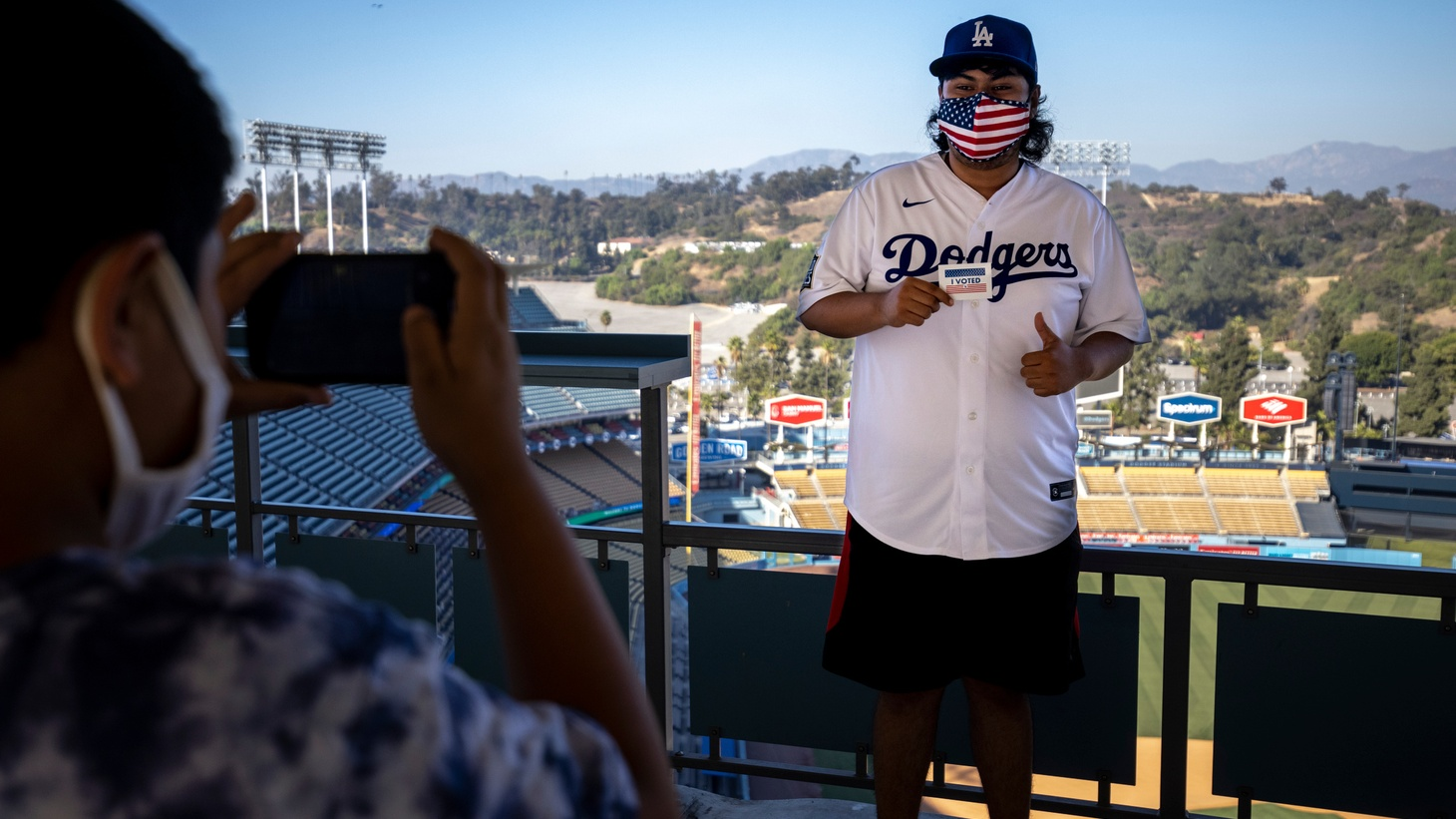 A voter poses for a photo after casting a ballots at Dodgers Stadium's voting center.