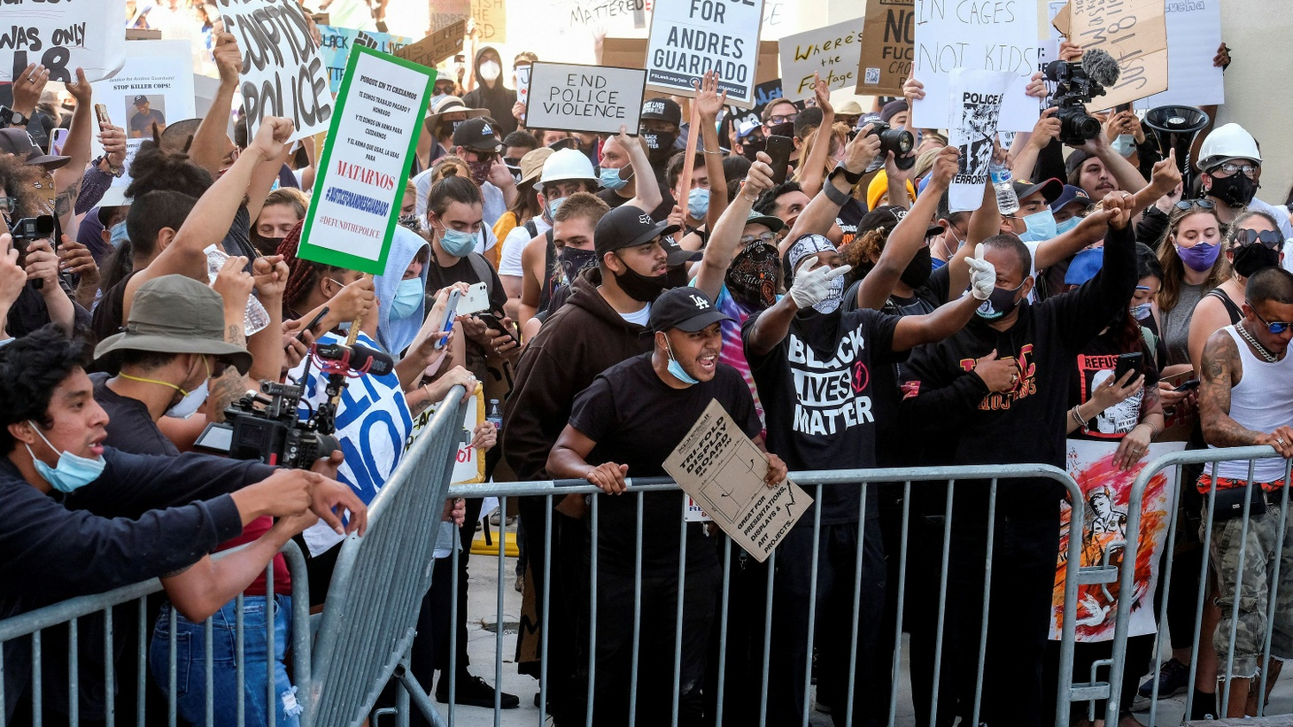 Demonstrators confront Los Angeles County sheriff's deputies in a protest against the death of 18-year-old Andres Guardado and racial injustice in Compton, California, U.S., June 21, 2020.