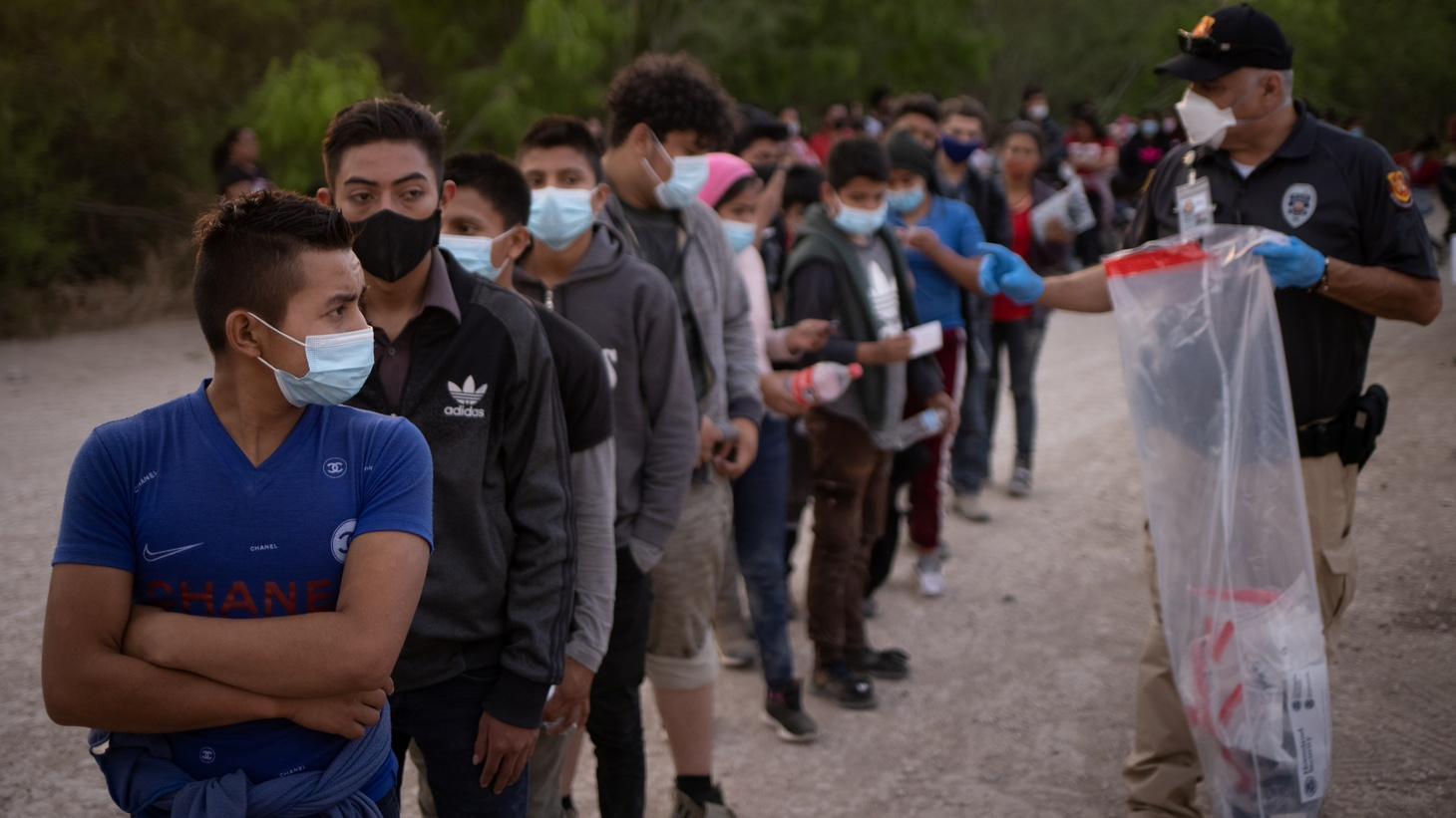 Unaccompanied minors from Central America line up to be transported by U.S. Customs Border Protection officials, after crossing the Rio Grande river into the United States from Mexico on rafts in Penitas, Texas, U.S., March 26, 2021. Picture taken March 26, 2021.