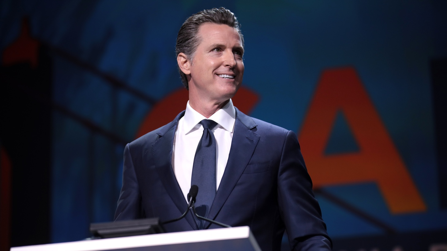 Governor Gavin Newsom made the announcement for a new regional stay-at-home order while quarantining at home. This time around, the restrictions will be triggered in regions running low on intensive care unit beds.