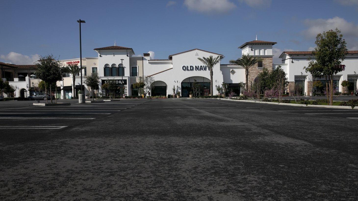 An empty parking lot in front of Old Navy at The Veranda shopping center in Concord on March 19, 2020. One third of the center's businesses have been forced to close temporarily due to the shelter in place order in Contra Costa and surrounding counties.