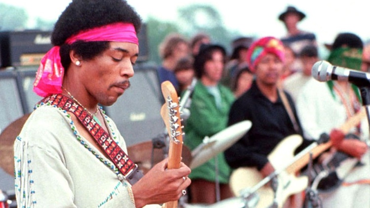 From Richie Havens to Jimi Hendrix, photographer Henry Diltz recalls his favorite moments of the historic festival.