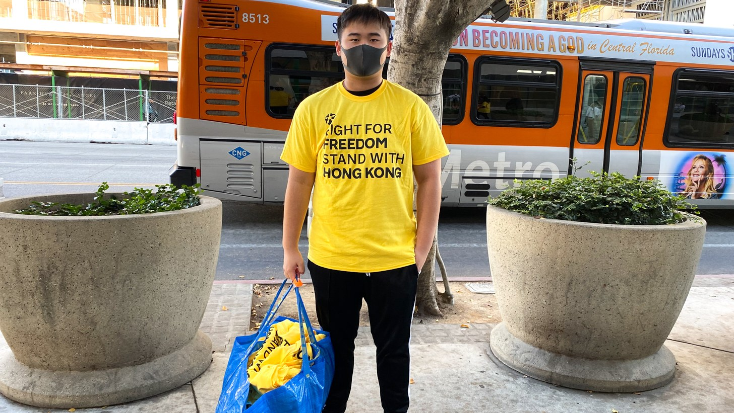 Sun Laren with his bag of protest shirts outside the Staples Center.