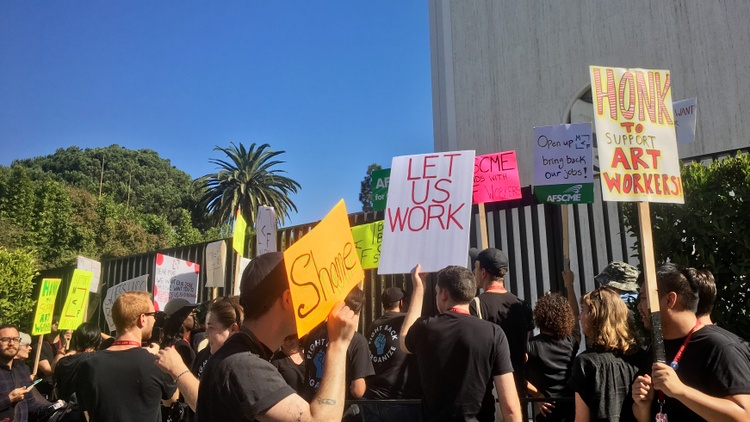 Dozens of fired employees protested in front of the now-shuttered Marciano Art Foundation on Friday.