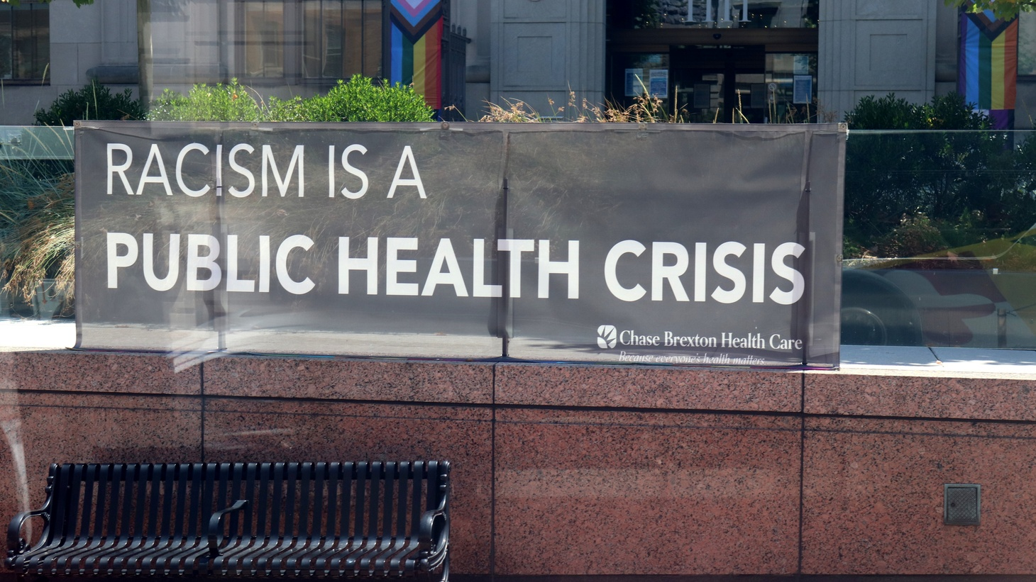 """A banner says """"RACISM IS A PUBLIC HEALTH CRISIS,"""" Baltimore, Maryland, July 9, 2020."""