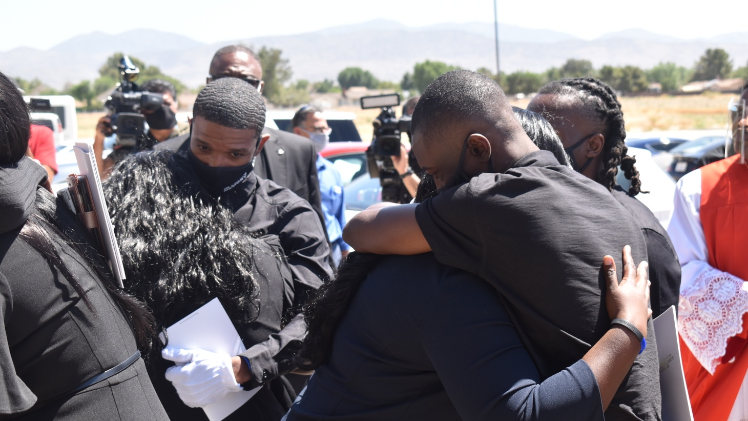 Members of the Fuller family embrace outside of Living Stone Cathedral of Worship in Littlerock, California.