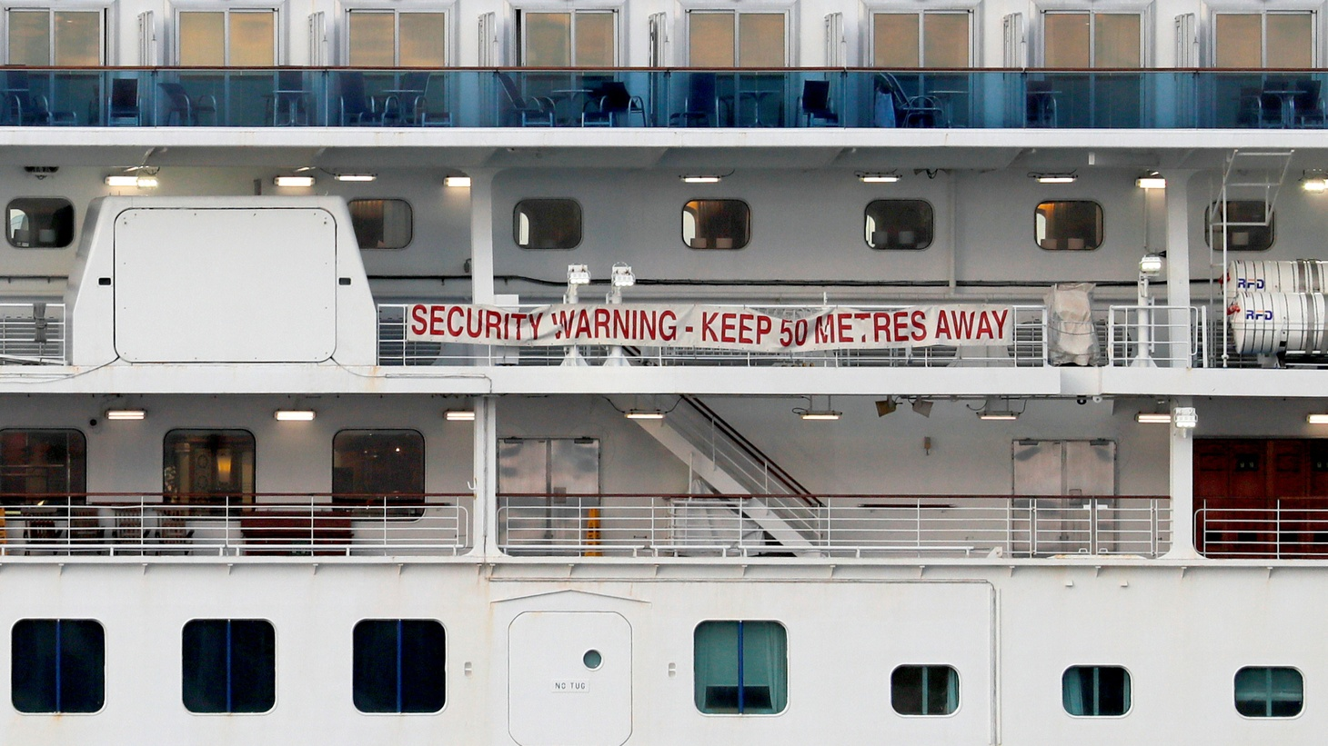 A banner is seen on the cruise ship Diamond Princess at Daikoku Pier Cruise Terminal in Yokohama, south of Tokyo, Japan February 12, 2020.