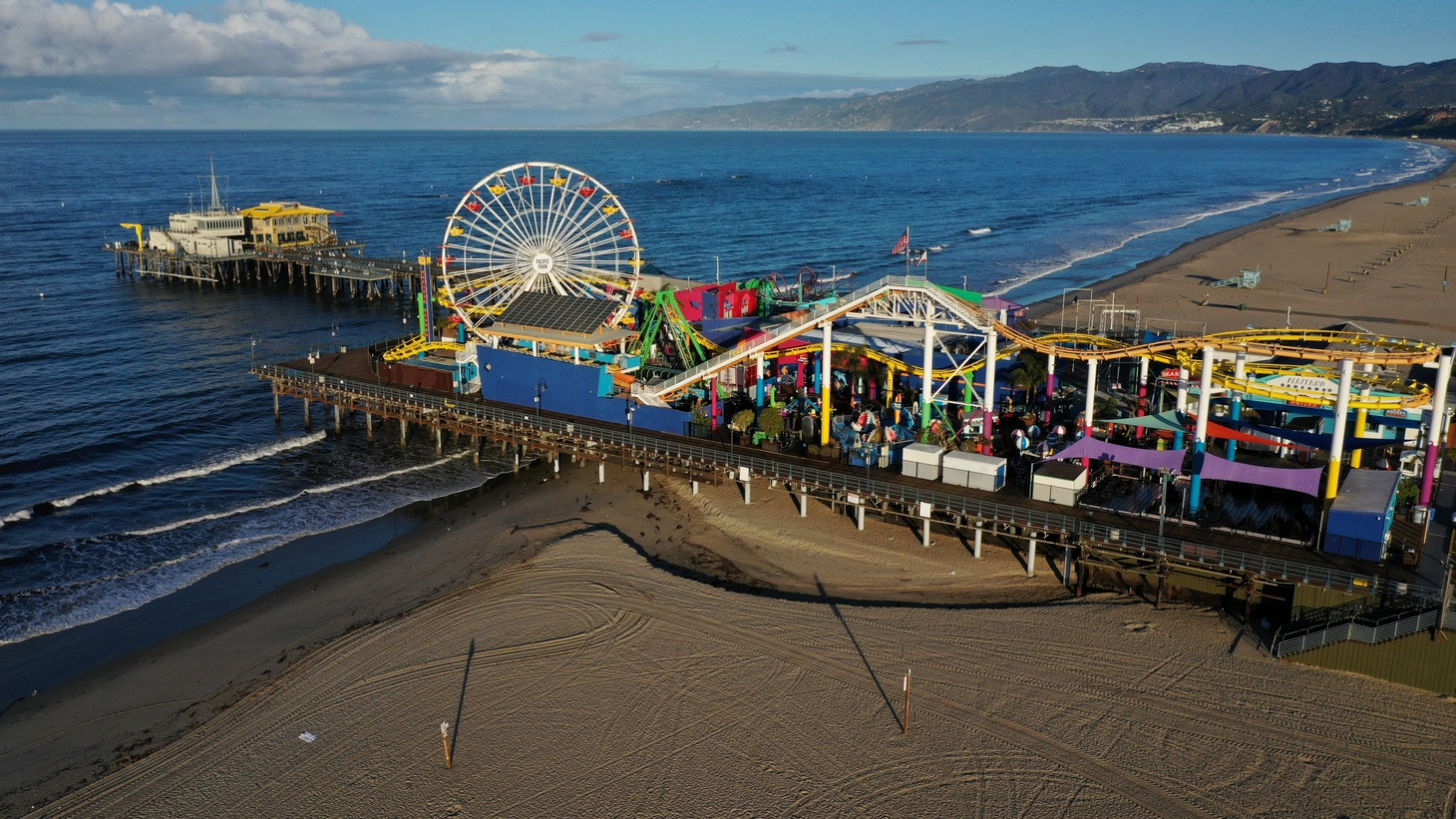 The Santa Monica pier and beaches on the Pacific Ocean are empty after California issued a stay-at-home order due to coronavirus disease (COVID-19) in Santa Monica, California, U.S., March 25, 2020.