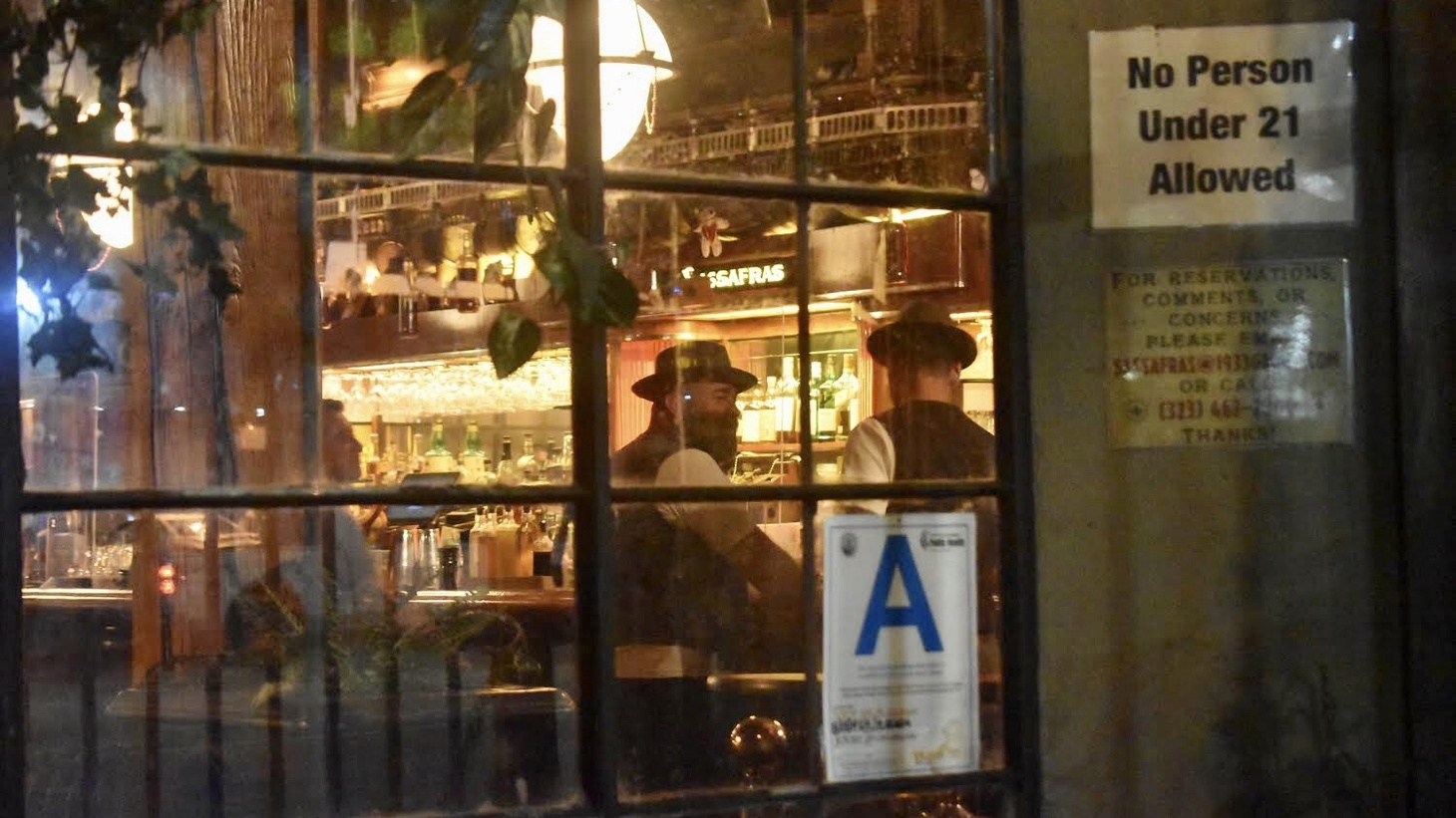 Men drink at the bar of the Sassafras Saloon in Hollywood on July 31, 2020.