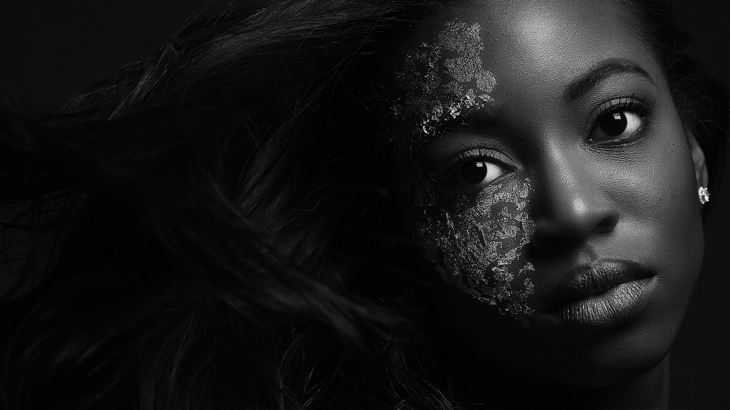 """""""Conceal to reveal. In life as humans, we face numerous battles that many of us never thought we would see an end to. But those moments in time have created scars that reveal the beauty of self and narrative, allowing you to shine through what had been some of your darkest times. Rock the scars that made you,"""" says Toya Golden."""