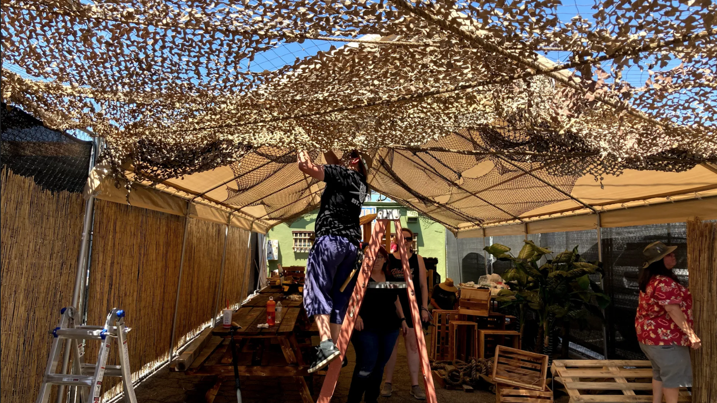 Dedicated Tonga Hut customers set up the netted roofing inside the lanai.