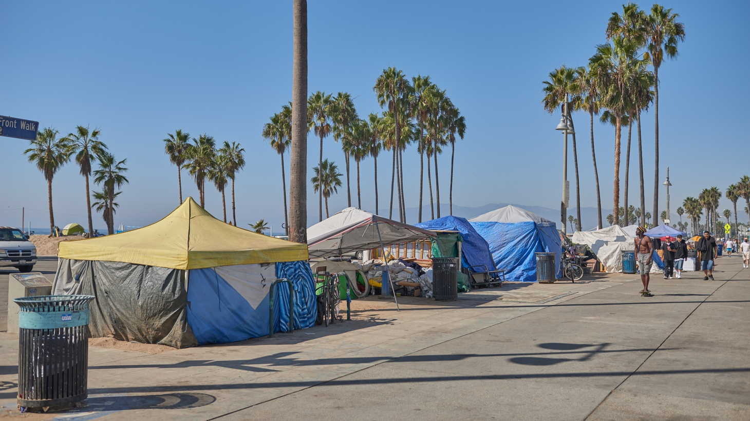 """Homeless encampments line the Venice Beach boardwalk. LA County Sheriff Alex Villanueva is pushing for the camps to be removed. But Venice Family Clinic CEO Elizabeth Benson Forer says, """"What are the intentions? Is he considering doing violent harm to people as a way to get them to go away? I'm not sure. What is his jurisdiction? Has he been ordered by the county supervisors to come in? … Why is this person popping up here and now?"""""""