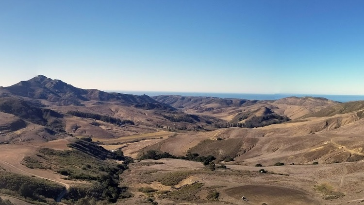 There aren't many roads or people outside the small city of Lompoc. Instead you'll see rolling hills, cattle grazing under oak trees, and rare birds like Golden Eagles.