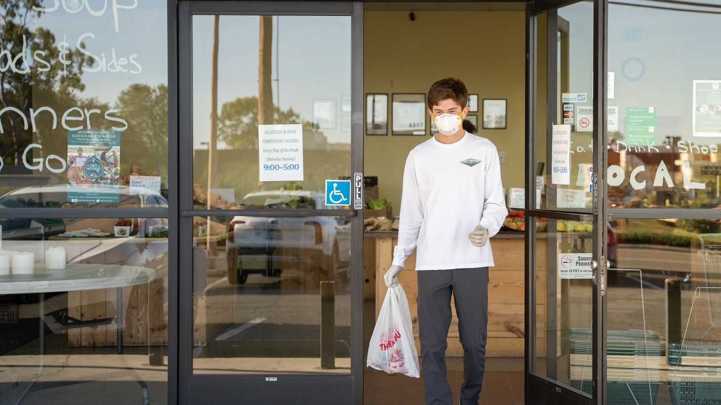 Volunteers for Zoomers to Boomers wear masks and gloves while shopping and delivery food.